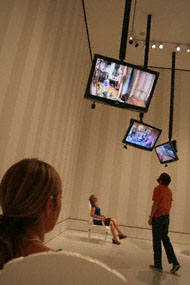 Visitors interact with Nicole Cohen's installation at the Getty Center