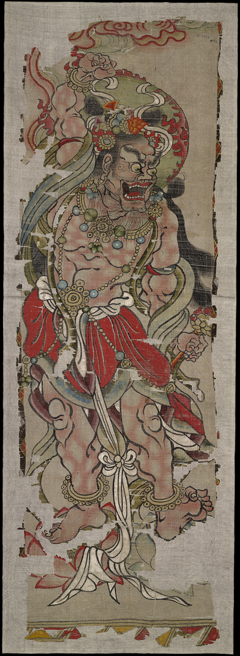 A wrathful, muscular form of the bodhisattva Vajrapaṇi, his mouth agape and a fierce look on his face, dominates this banner