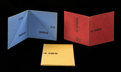 This trio of folded works printed on heavy red, yellow, and blue paper evokes the shape of boat sails. Each features four lines of verse: rosy far black / patched broken faded / lucky full / green fainter loath.