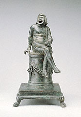 Incense Burner Shaped as a Comic Actor Seated on an Altar