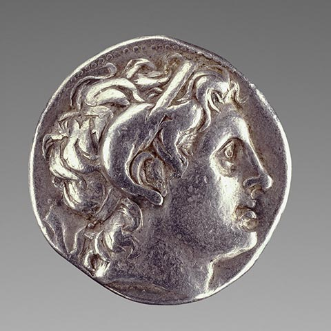 <em>Coin with Alexander the Great with the Horn of Zeus Ammon</em>, Greek, minted at Pella, 286-281 BC, silver. The J. Paul Getty Museum. Gift of Lily Tomlin