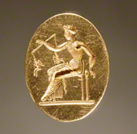 Ring with a Woman Weighing Eros Figures / Greek