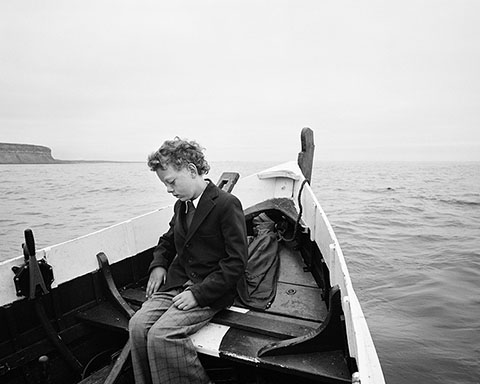 Simon Being Taken out to Sea for the First Time since His Father Drowned, Skinningrove, North Yorkshire, negative 1983; print 2014, Chris Killilp, gelatin silver print. Courtesy of and © Chris Killip.
