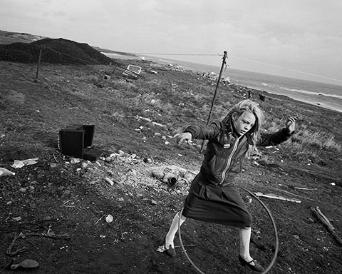 Helen and Her Hula-hoop, Seacoal Camp, Lynemouth, Northumberland, 1984, Chris Killip, gelatin silver print.  The J. Paul Getty Museum, purchased in part with funds provided by Alison Bryan Crowell, Trish and Jan de Bont, Daniel Greenberg and Susan Steinhauser, Manfred Heiting, Gloria Katz and Willar