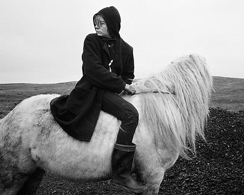 """Boo"" on a Horse, Seacoal Camp, Lynemouth, Northumberland, 1984, Chris Killip, gelatin silver print. The J. Paul Getty Museum, purchased with funds provided by the Photographs Council. © Chris Killip."