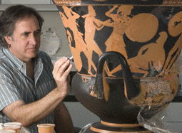 Conservator Jeff Maish positions ceramic fragments