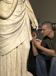 Conservator Erik Risser in-painting the Hope Hygieia