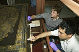 Conservators at work on the Mazarin Chest