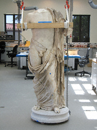 Statue of a God during conservation at the Getty Villa