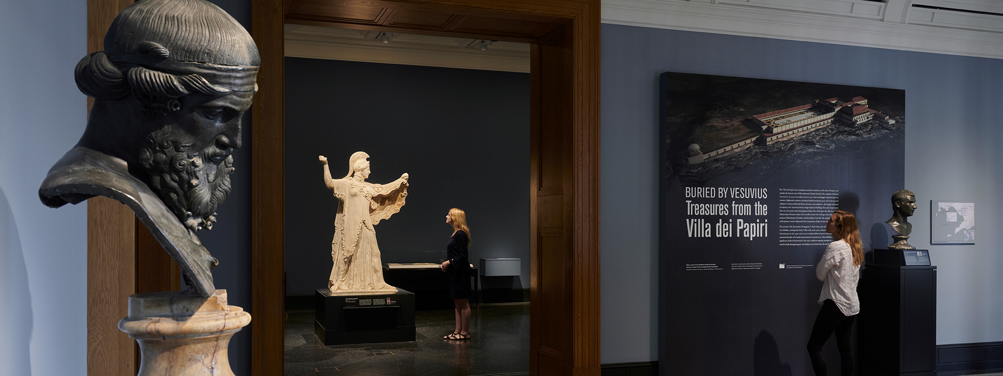 Gallery view: in the foreground, Priapus, first century BC; in the background, Athena Promachos (First in Battle), Roman, first century BC­–first century AD. Both works courtesy Museo Archeologico Nazionale, Naples