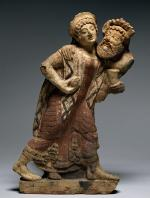 Antefix in the Form of a Maenad and Satyr Dancing