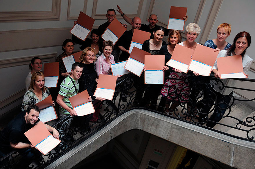 Course participants with their certificates