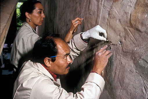 conservators filling plaster cracks