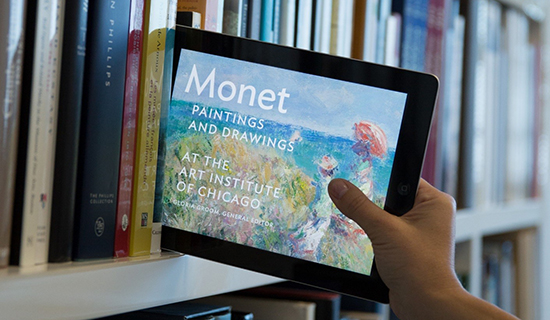 bookshelf with ipad showing online Monet catalogue