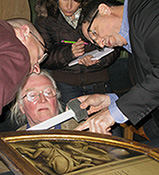 Experts examine the Ghent Altarpiece
