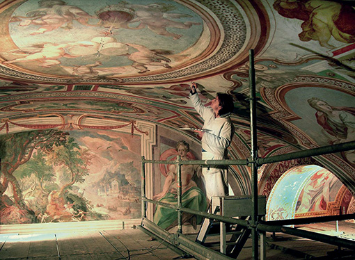 A conservator restores frescoes by Paul Bril