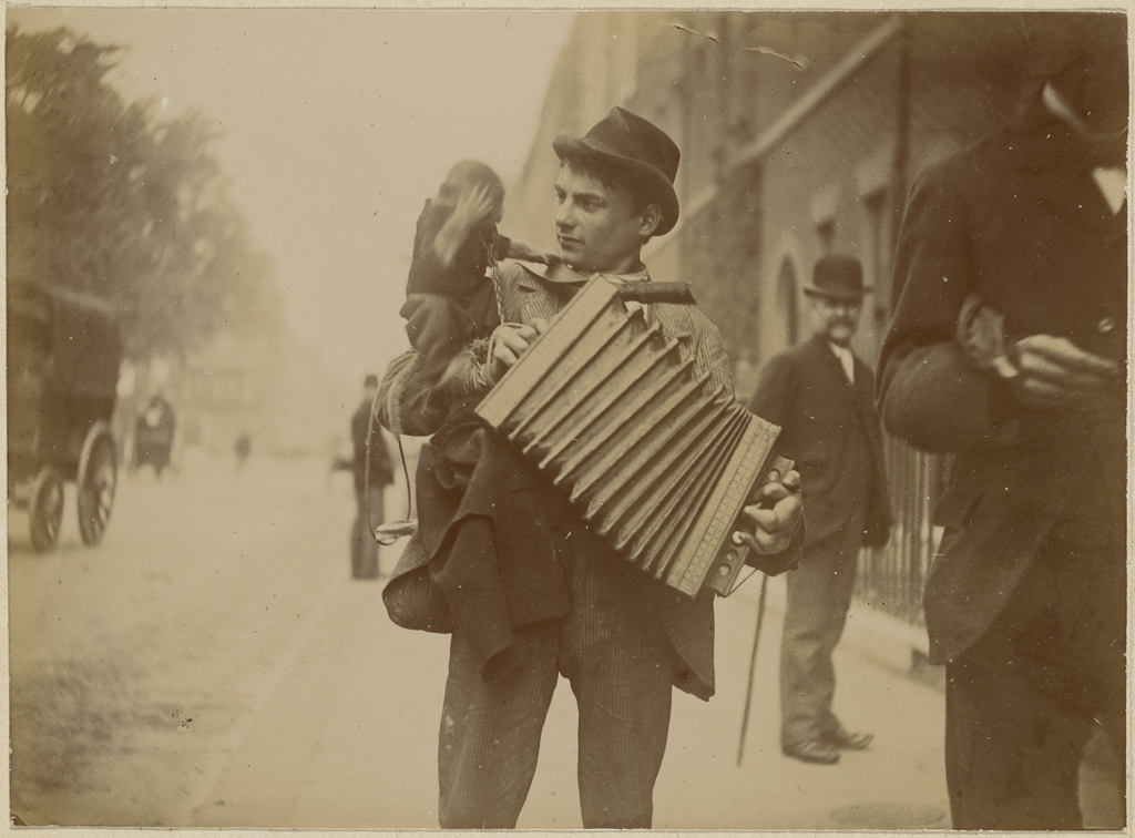 [Accordion player with...
