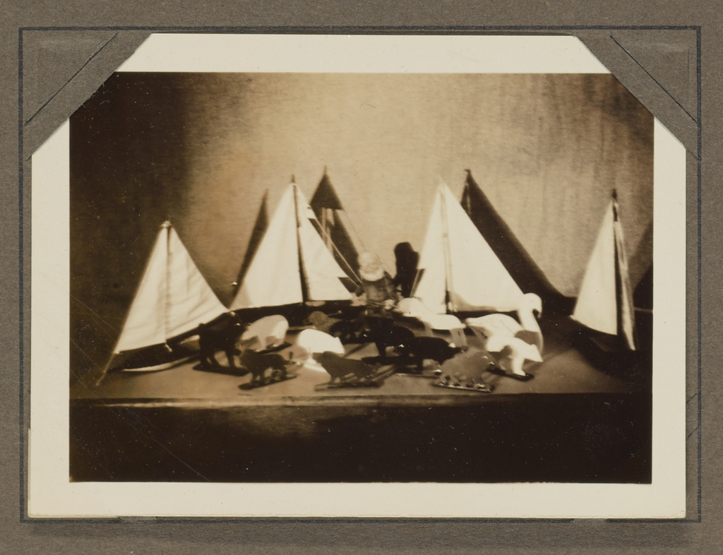 Still life with toy sailboats and animal figurines] (Getty