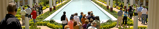 Visitors enjoy an architecture and gardens tour at the Getty Villa