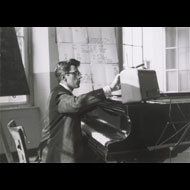 Unknown / David Tudor performing John Cage's Water Music in Darmstadt