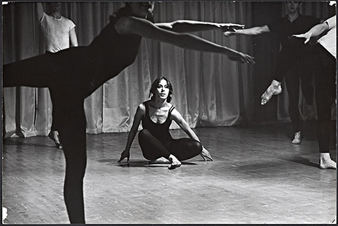 "Photograph of Yvonne Rainer dancing in the ""Bach"" sectoin of Terrain, 1963"