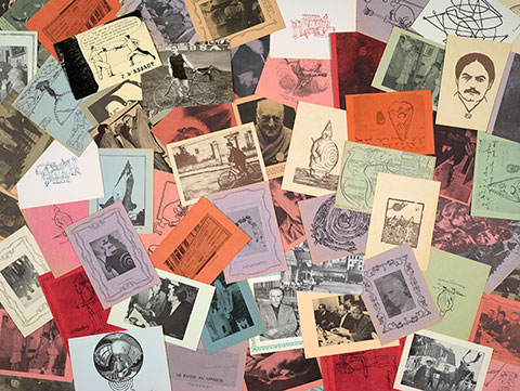 A scattering of postcards from the College of 'Pataphysics in pale blues, greens, oranges, pinks, and yellows, depicting a line drawing of writer Alfred Jarry's face, a whimsical map of the world, and photographs of men, among others.