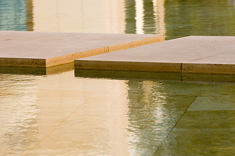 Image of a shallow water feature with travertine blocks in the Museum Courtyard.
