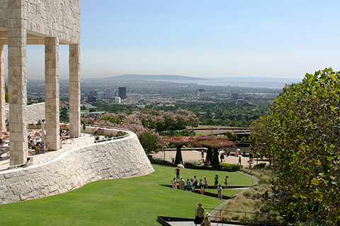The Central Garden lawn and J. Paul Getty Museum Garden Terrace Cafe with city view.