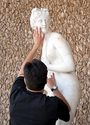 Visitors exploring a touchable marble sculpture of Venus at the Getty Villa