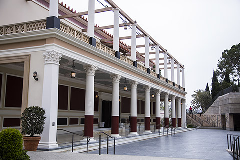 The front of the Getty Villa, a two-story building with columns on both levels.